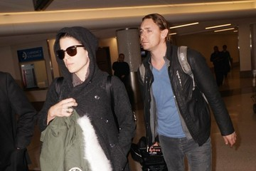 JJ Feild Neve Campbell and JJ Feild at LAX
