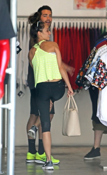 Lindsay Lohan back behind the wheel and back to shopping at the popular Maxfields Clothing store in West Hollywood, CA with an unidentified female friend
