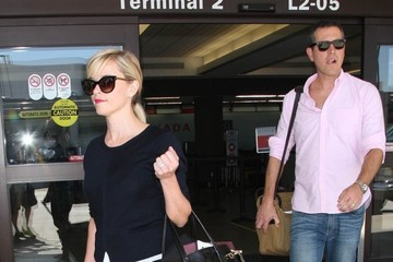 Jim Toth Reese Witherspoon & Jim Toth Touch Down At LAX