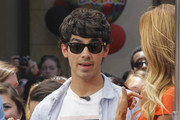 Singer Joe Jonas and singer Nelly celebrated Joe's birthday during an interview with Extra's TV host Renee Bargh at The Grove in Los Angeles, California on August 15, 2012. He was presented with a cake that had a picture of actor Daniel Craig on it. Fans had gifts for Joe as he left the show.