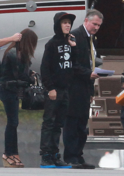Justin Bieber Pop sensation Justin Bieber arrives on a private jet at LAX airport with his parents on a rainy day in Los Angeles.