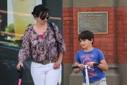 Model and actress Karen Duffy out and about in New York City, New York with her son Jack on September 4, 2013.