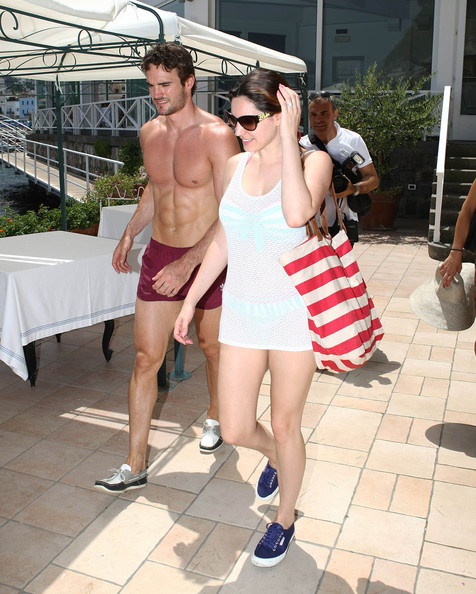 British model Kelly Brook and her boyfriend Thom Evans share a kiss after boarding a boat in Naples, Italy on July 11, 2012. The happy couple have been enjoying a sun-filled vacation on the island...