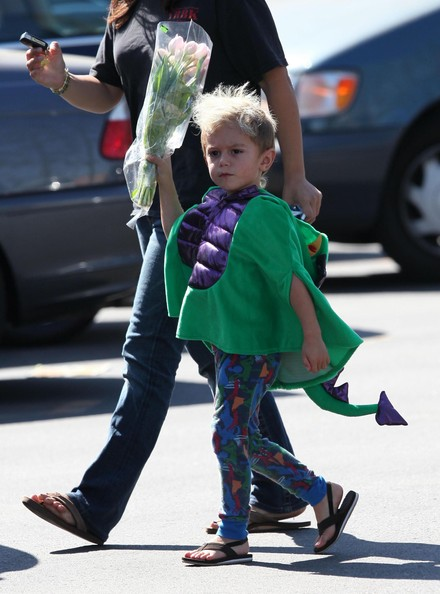 Gwen Stefani and Gavin Rossdale's son Kingston Rossdale out buying flowers at Ralph's with his nanny. Kingston was wearing a dragon costume and pointing the flowers at photographers like it was a gun.