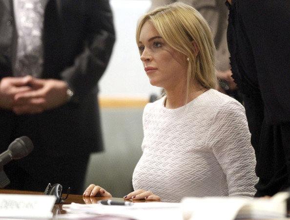 Lindsay Lohan Actress Lindsay Lohan in court with her Lawyer Shawn Chapman Holley, for her arraignment at the Airport Courthouse on February 09 2011 in Los Angeles, California. Lohan was charged with a felony count of grand theft for allegedly stealing a 2,500 necklace from a jewelry store in Venice.