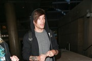 Louis Tomlinson arriving at LAX airpot in Los Angeles, California on March 17, 2016.  Louis' girlfriend was in the car waiting for him.
