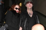 Goth singer Marilyn Manson and his girlfriend Lindsay Usich arriving on a flight at LAX airport in Los Angeles, California on November 14, 2012.