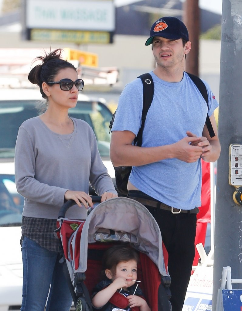 Mila Kunis and husband Ashton Kutcher with their son