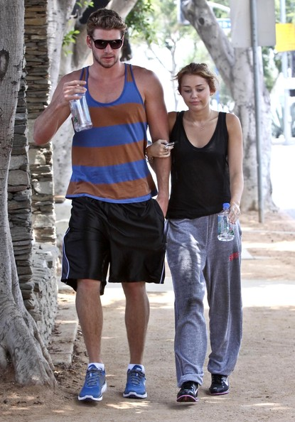Miley Cyrus and Liam Hemsworth Photos Photos - Miley Cyrus ...