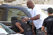 Singer Naomi Campbell does a bit of shopping with her trainer/boyfriend Vladislav Doronin in Ibiza on June 4th, 2012.