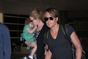 'Paddington' actress Nicole Kidman arriving on a flight at LAX airport in Los Angeles, California with her husband Keith Urban and their two daughters Faith & Sunday on January 2, 2014.
