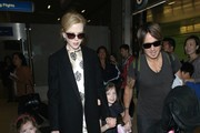 """Before I Go To Sleep"" star Nicole Kidman, her husband Keith Urban and their daughters Sunday and Faith arrive on a flight at LAX Airport on July 2, 2014 in Los Angeles, California. The couple returned from Australia where Urban serenaded his wife with a song during his concert to mark their eight year anniversary!"