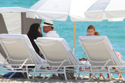 'Oblivion' actress Olga Kurylenko and her boyfriend Danny Huston share a kiss while out on the beach with Danny's daughter Stella in Miami, Florida on October 20, 2012.