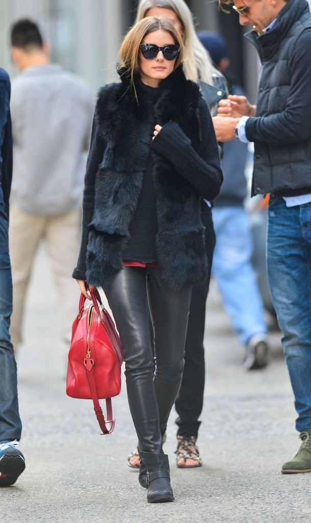 Socialite Olivia Palermo and her boyfriend Johannes Huebl out with friends in New York City, New York on October 14, 2013.