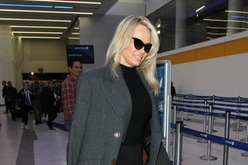 Pamela Anderson Pamela Anderson Departs From LAX