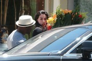 Detroit Lions running back Reggie Bush and his fiance Lilit Avagyan stop to buy flowers on Mother's Day in Beverly Hills, California on May 11, 2014. While leaving the shop, Reggie doesn't help Lilit carry the huge bouquet back to the car!