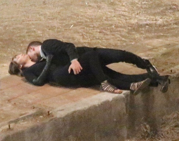 Actor Robert Pattinson locks lips with Mia Wasikowska as they film a scene for their new film 'Maps to the Stars' in an abandoned lot on August 21, 2013 in Los Angeles, California. Between takes, director David Cronenberg spoke to the pair about the scene.