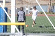 Rocker Rod Stewart plays soccer with his sons Sean and Alastair at a soccer game in Woodland Hills, California on November 2, 2013.