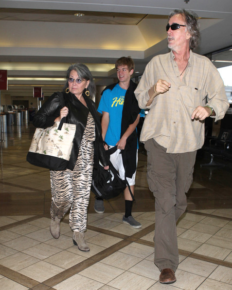 roseanne barr departing on a flight at lax