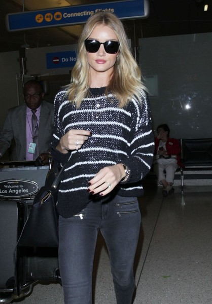Rosie Huntington-Whiteley Arriving On A Flight At LAX