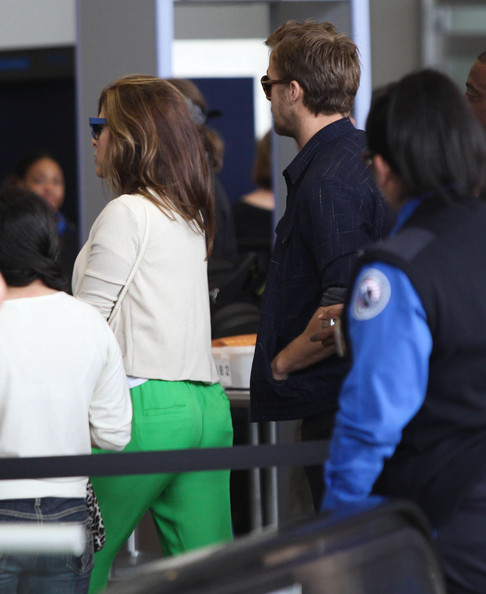 Eva Mendes And Ryan Gosling Arriving For A Flight At LAX []