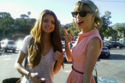 Singers Selena Gomez and Taylor Swift out for lunch at Paradise Cove in Malibu, California on June 27, 2012. On the way out the two posed for fans and gave a thumbs up to the camera