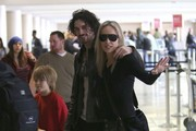 Actress Sharon Stone, her boyfriend Martin Mica and her sons Roan, Laird and Quinn departing on a flight at LAX airport in Los Angeles, California on December 23, 2012.