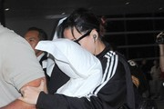 Shy Katy Perry Arriving On A Flight At LAX