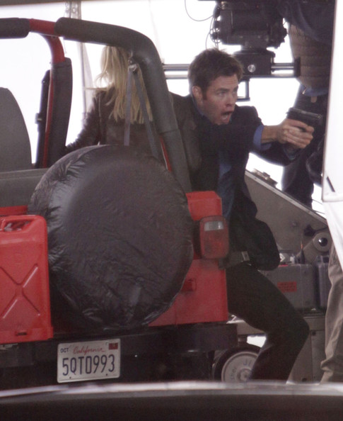 Actress Reese Witherspoon, Tom Hardy and Chris Pine on the set of 'This Means War' in Vancouver, Canada. They were filming a scene where Reese is tied up and Tom has a shotgun, during their getaway Chris pulls out his gun.