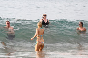 The Hilton clan enjoy a family dip in the warm waters of Hawaii while on their Christmas vacation. Rick & Kathy Hilton were joined by daughters Paris & Nicky along with their beaus David Katzenberg and Cy Waits and their son Baron Hilton.