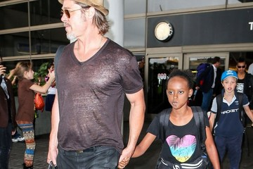Zahara Jolie-Pitt Brad Pitt and Angelina Jolie Arrive on a Flight at LAX With Their Kids