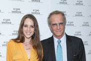 Christopher Lambert (R) and Eleanor Lambert attend the New York Premiere of 10 DAYS IN A MADHOUSE at AMC Empire on November 11, 2015 in New York City.