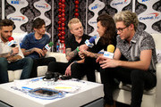 Radio personality JoJo Wright (C) speaks with recording artists (L-R) Liam Payne, Louis Tomlinson, Harry Styles and Niall Horan of music group One Direction at 102.7 KIIS FMÂ's Jingle Ball 2015 Presented by Capital One at STAPLES CENTER on December 4, 2015 in Los Angeles, California.