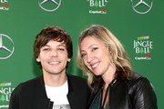 (EDITORIAL USE ONLY. NO COMMERCIAL USE.) (L-R) Louis Tomlinson and KIIS-FM Assistant Program Director - Music Director Beata Murphy attends 102.7 KIIS FM's Jingle Ball 2019 Presented by Capital One at the Forum on December 6, 2019 in Los Angeles, California.