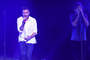Recording artists Liam Payne (L) and Louis Tomlinson of One Direction perform onstage during 102.7 KIIS FMÂ's Jingle Ball 2015 Presented by Capital One at STAPLES CENTER on December 4, 2015 in Los Angeles, California.