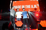 (L-R) Recording artists Niall Horan, Liam Payne and Louis Tomlinson of One Direction perform onstage during 102.7 KIIS FMÂ's Jingle Ball 2015 Presented by Capital One at STAPLES CENTER on December 4, 2015 in Los Angeles, California.