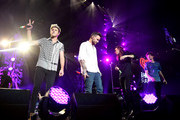 (L-R) Recording artists Niall Horan, Liam Payne, Harry Styles and Louis Tomlinson of One Direction perform onstage during 102.7 KIIS FMÂ's Jingle Ball 2015 Presented by Capital One at STAPLES CENTER on December 4, 2015 in Los Angeles, California.