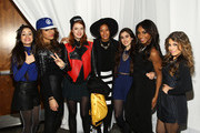 (L-R) Singers Camila Cabello and Dinah-Jane Hansen of Fifth Harmony, Caroline Hjelt and Aino Jawo of Icona Pop, and Lauren Jauregui, Normani Hamilton, and Ally Brooke of Fifth Harmony pose backstage at 106.1 KISS FM's Jingle Ball 2013, at Comcast Arena at Everett on December 8, 2013 in Seattle, Washington.