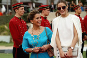 HRH Princess Haya Bint Al Hussein walks down the red carpet with actress Olivia Palermo on the final day of the Cartier International Dubai Polo Challenge 10th edition at Desert Palm Hotel on February 21, 2015 in Dubai, United Arab Emirates. The event takes place under the patronage of HRH Princess Haya Bint Al Hussein, Wife of HH Sheikh Mohammed Bin Rashid Al Maktoum, Vice-President and Prime Minister of the UAE and Ruler of Dubai.  The Cartier International Dubai Polo Challenge is one of the most prestigious happenings in Dubai's sporting and social calendar. On this occasion Cartier launched their latest watch creation Cle De Cartier.