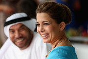 HRH Princess Haya Bint Al Hussein and Ali Al Bawardi watch the action on the final day of the Cartier International Dubai Polo Challenge 10th edition at Desert Palm Hotel on February 21, 2015 in Dubai, United Arab Emirates. The event takes place under the patronage of HRH Princess Haya Bint Al Hussein, Wife of HH Sheikh Mohammed Bin Rashid Al Maktoum, Vice-President and Prime Minister of the UAE and Ruler of Dubai.  The Cartier International Dubai Polo Challenge is one of the most prestigious happenings in Dubai's sporting and social calendar. On this occasion Cartier launched their latest watch creation Cle De Cartier.