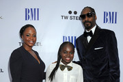 (L-R) Shante Broadus, Cori Broadus and rapper Snoop Dogg arrive at the 11th Annual BMI Urban Awards on August 26, 2011 in Los Angeles, California.
