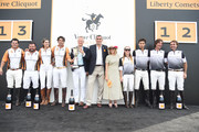 (L-R) Marcelo Amadeo Videla, Miguel Mendoza, Delfina Blaquier, Nacho Figueras, Philippe Schaus, Jean-Marc Gallot, Aygline Pechdo, Sarah Siegel-Magness, Agustin Bottaro, Jose Donoso, and Johnny Redlich pose on stage after the 11th annual Veuve Clicquot Polo Classic at Liberty State Park on June 2, 2018 in Jersey City, New Jersey.