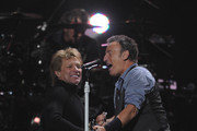 "Musicians Jon Bon Jovi (L) and Bruce Springsteen perform at ""12-12-12"" a concert benefiting The Robin Hood Relief Fund to aid the victims of Hurricane Sandy presented by Clear Channel Media & Entertainment, The Madison Square Garden Company and The Weinstein Company at Madison Square Garden on December 12, 2012 in New York City."