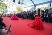 Indian actress Aishwarya Rai Bachchan and British-Thai actress Araya Hargate (L) pose as they arrive on May 20, 2017 for the screening of the film '120 Beats Per Minute (120 Battements Par Minute)' at the 70th edition of the Cannes Film Festival in Cannes, southern France.  / AFP PHOTO / Valery HACHE