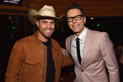 Dustin Lynch (L) and Bobby Bones take photos during the 12th Annual ACM Honors at Ryman Auditorium on August 22, 2018 in Nashville, Tennessee.