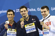 (L-R) Eugene Godsoe of the USA, Florent Manaudou of France and Stanislav Donect of Russia celebrates on the podium after the Men's 50m Backstroke Final during day four of the 12th FINA World Swimming Championships (25m) at the Hamad Aquatic Centre  on December 6, 2014 in Doha, Qatar.
