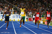 (L-R) Tyson Gay of United States, Usain Bolt of Jamaica, Daniel Bailey of Antigua and Barbuda and Marc Burns of Trinidad and Tobago compete in the men's 100 Metres Final during day two of the 12th IAAF World Athletics Championships at the Olympic Stadium on August 16, 2009 in Berlin, Germany.