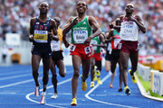 (L-R) Bernard Lagat of United States, Kenenisa Bekele of Ethiopia and James Kwalia C'Kurui of Qatar compete in the men's 5000 Metres Final during day nine of the 12th IAAF World Athletics Championships at the Olympic Stadium on August 23, 2009 in Berlin, Germany.
