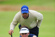 Gonzalo Fernandez-Castano and Alvaro Quiros of Spain line up a putt during a practice round prior to the 138th Open Championship on the Ailsa Course, Turnberry Golf Club on July 14, 2009 in Turnberry, Scotland.