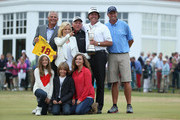Phil Mickelson of the United States holds the Claret Jug wife Amy and children Evan, Amanda and Sophia.former coach Steve Loy, coach Butch Harmon and caddie Jim Mackay after winning the 142nd Open Championship at Muirfield on July 21, 2013 in Gullane, Scotland.